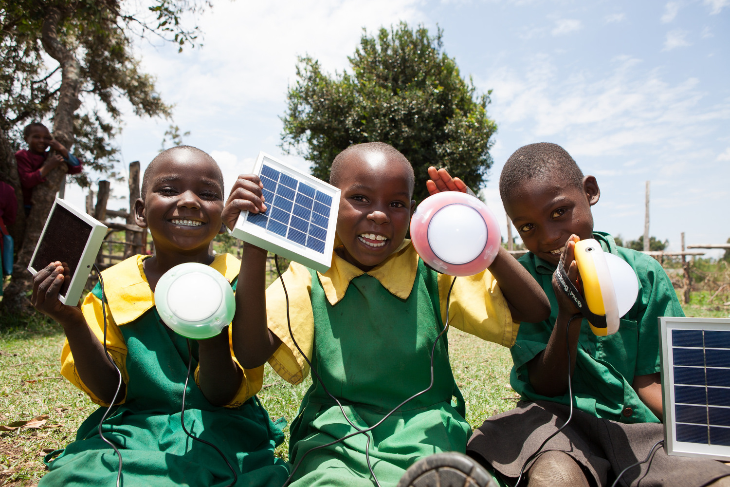 African kids with lights and solar panels